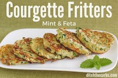 Super easy recipe for courgette mint and feta fritters. These tick so many boxes - wheat free, low carb, and packed with greens. | ditchthecarbs.com
