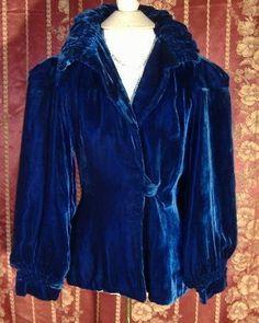 Vintage (or at least vintage-y) blue velvet with amazing sleeves.