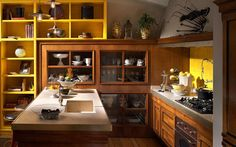 Rustic kitchen with yellow shelves and decorations