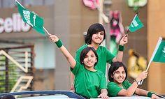 Saudi Arabian children celebrating National Day