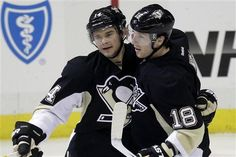 03/05/12 - Pittsburgh Penguins' Chris Kunitz celebrates his first-period goal with teammate James Neal. Pens prevail over Coyotes, 2-1