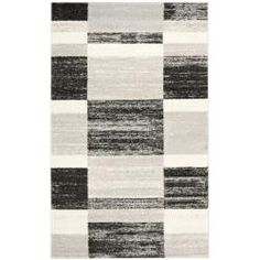 @Overstock - Give your room's decor a modern upgrade with this contemporary-styled gray rug. These powerloomed rugs feature a variety of abstract patterns consisting of muted black and gray squares, creating a stunning contrast that serves as a decorative accent. http://www.overstock.com/Home-Garden/Deco-Inspired-Black-Light-Grey-Rug-8-x-10/6565582/product.html?CID=214117 $309.99