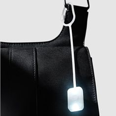Bag Light: Fellina Sok-Cham, 2009     Attach this pocket light with a super-bright LED to your hand bag and easily illuminate its interior when retrieving items. Press and hold the center button to activate the light. Magnetic closure. Made of silicone rubber with an ABS back. $9 from MOMA store