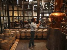 Ted Green checks on the distilling area at La Colombe's new shop in the Fishtown section of Philadelphia on November 20, 2014.