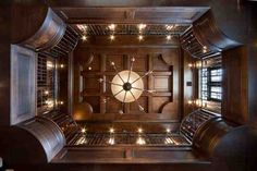 Ravelais: French Castle luxury home design by John Henry Architect Luxury house Interiors French panelled Library fab Library paneling ceiling and railing detail