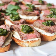 Beef Tenderloin Crostini with Whipped Goat Cheese and Pesto. This flavor-packed appetizer is a serious crowd-pleaser.