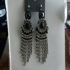 Chandelier Dangle Earrings Black, Gray & Clear These lovely statement earrings come with stones in black, gray & clear. Brand new, but looks like one clear stone may be missing from right earring. Can barely notice it. Express Jewelry Earrings