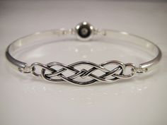 Sterling Silver Discreet Slave Bracelet / Locking Cuff w/ Celtic Knot & Allen Key Clasp - Sized to Order by SkyeWireDesigns on Etsy https://www.etsy.com/listing/249456128/sterling-silver-discreet-slave-bracelet