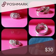 Engagement or wedding ring SS  platinum clad to prevent tarnishing. CZ stones, all well seated, brilliant shine and sparkle. Jewelry Rings