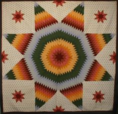 """Lone Star Quilt: Circa 1870; Pennsylvania      Dramatic Lone Star quilt (aka Star of Bethlehem) with the most unusual of background fabrics. It's a print I've never seen before that has the profile of a woman. It may be earlier than the calicoes of the star. Unwashed condition. Some oxidation to the solid orange fabric. Measures 100"""" square, unusually large for the 1870's when it was made. Pennsylvania origin"""