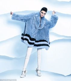 Quick changes: Kendall posed in upwards of 15 different outfits for the shoot, including this fluffy blue fur coat