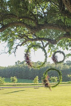 Hula hoop with neon ribbon and flowers and use for backdrop of ceremony