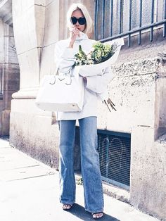 The Haute Pursuit in a cozy knit and flared jeans