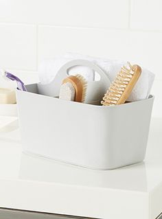"""The perfect organizer to keep bathroom accessories   Waterproof plastic with 4 handy compartments   Built-in moulded handle   10"""" x 6"""" x 7"""""""