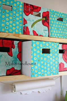 Banker's boxes: an easy and inexpensive way to create your own decorative storage by using fabric, wall paper or children's artwork