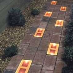 These solar brick lights would be great along the edges of a walkway.