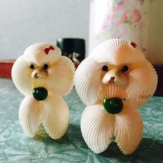 DOG~ POODLE ORNAMENTS MADE FROM SEA SHELLS.