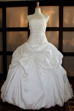 DON'T LIKE - too high on waist, makes hips look bigger, too symmetrical at center, maybe drop one side of skirt bodice? Strapless Ball Gown Taffeta wedding dress