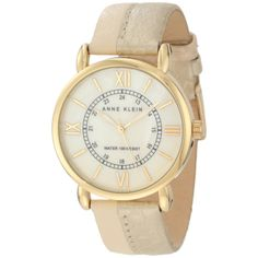 This stunning women's watch from Anne Klein features a stainless steel case with a coordinating gold calfskin leather strap. The beige dial sets the stage for gold hands and gold hourly Roman numerals for precise time-telling.