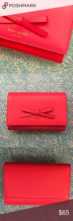 Kate Spade Wallet in Dark Coral Red This beautiful wallet is brand new, never used, and even comes in its original packaging with a Kate spade shopping bag. Those parts are not cosmetically bueno, but that's but why you're here is it? No, you're here for this fabulous wallet that's not quite cherry red, not quite coral, but a unique hybrid love child of the two. kate spade Bags Wallets