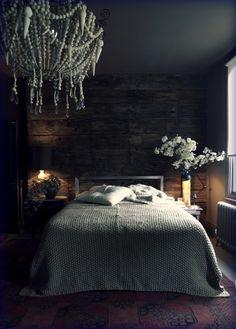 dark and moody cabin bedroom, wood plank walls, chandelier