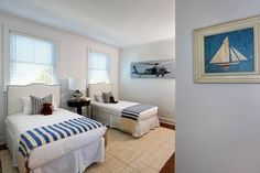 I like this seaside cottage guest room. The helicopter is a bit random, but maybe it's an inside thing for the homeowner? My brother would call the bed closest to it, though!