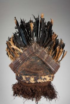 Mask from the Binji people of Congo | Woven plaited hood, abrus seeds, feathers and paint