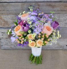 Gorgeous purple, lilac, apricot and peach bouquet. Featuring David Austin Roses, Tulips, Stocks, Hypericum Berry, Freesia, Misty and Matricaria Daisy.