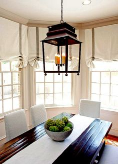 love the simplicity of this breakfast nook, perfect with my antique english kitchen table.