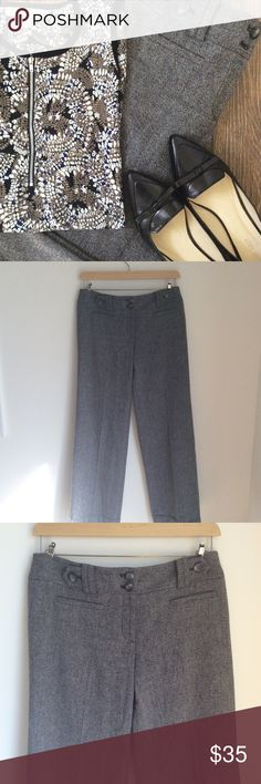 Ann Taylor Signature Fit Size 6 Gray Cuffed Pants Ann Taylor Signature Fit (Lower on waist) size 6 Gray Cuffed Dress Pants. 58% polyester, 42% wool with 100% polyester lining. Thicker, tweed style design with chic cuffed bottoms and button accents on belt loops. A playful, chic twist on the classic gray dress pant. Ann Taylor Pants Trousers