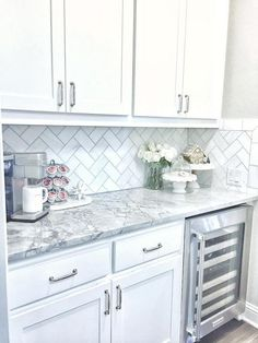 The backsplash is Daltile m313 contempo white marble 3×6 tile laid on herringbone.