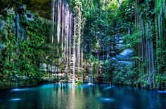 Cenote Ik Kil in Cancun | The pool is popular, but its 200-foot diameter ensures that there's plenty of room for swimmers even on the busiest days. The pool is accessed by a wooden staircase and boardwalk, which descends from a tourist complex that includes a restaurant, changing rooms, and several cabins available for overnight rental.   If you go: Also a day trip from Cancun (125 miles), it's possible to take a tour bus or taxi. You may want to debark in the nearby town of Chichén Itzá and…