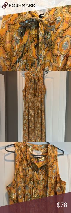 Beautiful Anthropologie dress size 14 This gorgeous number feels vintage but modern. Gorgeous metallic thread, brass buttons, fully lined, Midi length. Anthropologie Dresses Midi