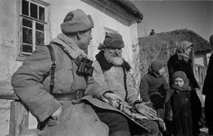 Colonel Ivan A. Gusev, commander of the 248th Independent Infantry Brigade, converses with farmers at a liberated village west of Kursk in the closing months of 1943. In July 1943, the Soviet army delivered a resounding defeat to German arms during the Battle for the Kursk Salient, which is still the biggest armored engagement in the history of warfare.