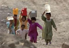 Afghanistan children carry water on a hillside in Kabul November 5, 2009.  Western Elite militarism.  Afghanistan nine years of Western attack and occupation.  Picture: REUTERS/Ahmad Masood