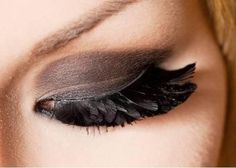 I like these feather eyelashes...although I would probably never wear them.