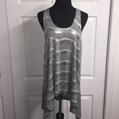 Bebe sequin tunic Make a statement...Sequined tunic top! Super cute. Layer with jeggings or leggings. bebe Tops Tunics