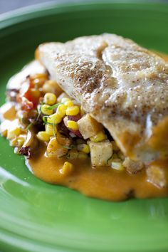 Sautéed Redfish with Chanterelles, Creole Tomato Confit, Corn, Brabants, and Spicy Beurre Blanc By Sue Zemanick, Executive Chef of Gautreau's in New Orleans, Louisiana. Photography by Chris Granger.