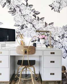 black and white flowers on the wall and a gold bunny chair at the desk