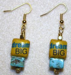 "Handcrafted by Teal Palmetto, LLC. This pair of earrings expresses what everyone should do!  Decoupaged ""dream BIG"" beads combine with gold metal and square marbelized teal beads to complete the look.  This pair has gold fish hook ear wires.  Price: $12."