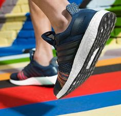 bb26f87e7b39 The adidas Ultra Boost and adizero Prime Boost is rendered with rainbow  accents for its latest iteration this season.
