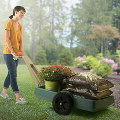 The Simplay3 Easy Haul Flat Bed Cart is highly maneuverable with heavy garden loads like mulch and flowers.