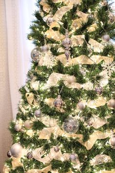 I'll be twirling and redoing our ribbon on our tree tomorrow to look more like this.  :)  BEAUTIFUL!