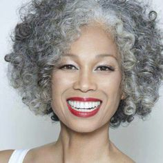 Grey hair can either look shiny and luminous or wiry, coarse and dry. In fact, choosing to go natural by allowing your grey hair to remain uncovered by dyes . My Hairstyle, Afro Hairstyles, Curly Hair Styles, Natural Hair Styles, Natural Beauty, Pelo Afro, Grey Wig, Pelo Natural, Ageless Beauty