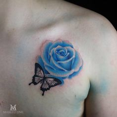 Adam Howard's brilliant first attempt at a colour realism Rose. Tattoo done at Marked One Tattoo.