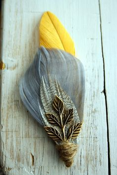 Marigold Feather Boutonniere.