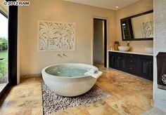This bath tub adds serenity to the room