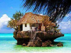 House on a rock in the Ocean beach ocean sea house rock architecture unusual