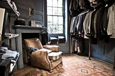 Men's Closet  #Closet #Decor #Mens    A well illuminated dressing area is always a wonderful thing! Love the triple hanging system on one wall & the shelving on the other - good way to maximize your space.
