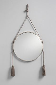 Price on request Circa 1920, the Émile-Jacques Ruhlmann mirror belonged to a private European collection and has been manufactured in Paris. This extremely rare Art Deco mirror features silver-plated bronze, a plain round frame and carries two tassels creating an elegant and classical design. Please note this mirror is in very good vintage condition featuring minor condition flaws such as mild scratches to the mirrored glass. Its wear is consistent with age and use, and its frame and…